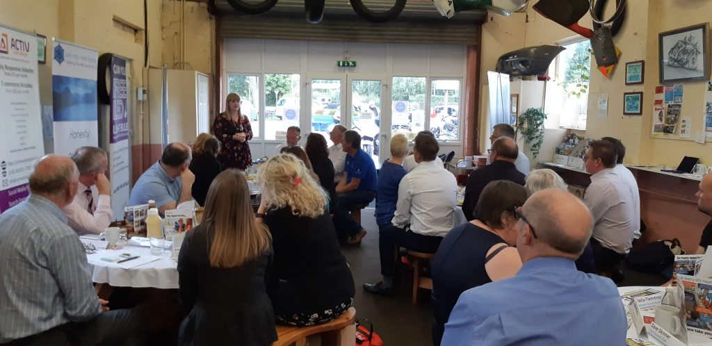 a talk at a busy networking event